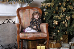 Little girl  at the Christmas tree Stock Image