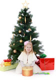 Little girl at the Christmas tree Royalty Free Stock Photos