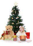 Little girl at the Christmas tree Stock Photography