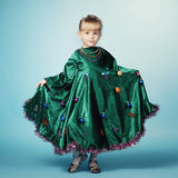 Little girl with christmas tree dress Stock Image