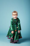 Little girl with christmas tree dress Stock Photos