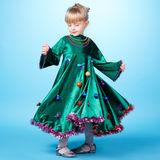 Little girl with christmas tree dress Royalty Free Stock Photo