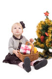 Little girl with Christmas tree and gifts Stock Images