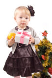 Little girl with Christmas tree and gifts Stock Photography