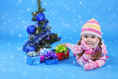 Little girl with the Christmas tree and gifts Royalty Free Stock Photo
