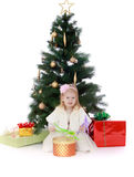 Little girl at the Christmas tree Royalty Free Stock Images