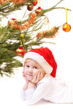Little girl with christmas tree isolated on white Royalty Free Stock Photo
