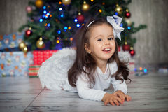 Little girl on christmas with a tutu skirt Royalty Free Stock Photography