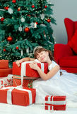 Little girl on Christmas. A little girl under the tree on Christmas royalty free stock photo