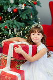 Little girl on Christmas. A little girl under the tree on Christmas stock photo