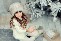 Little girl on Christmas. A little girl under the tree on Christmas stock photography