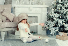 Little girl on Christmas. A little girl under the tree on Christmas stock image