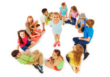 Little girl in circle of friends from above Stock Photography