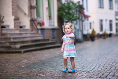 Little girl in a city Stock Photo