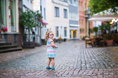 Little girl in a city Stock Photography