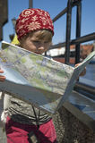 Little girl with a city map. travel Royalty Free Stock Photography