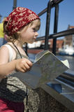 Little girl with a city map. travel Stock Image