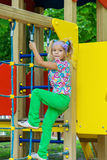 Little girl on city playground Royalty Free Stock Image