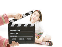 Little girl with a clapperboard Royalty Free Stock Photos