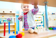 Little girl in the classroom early development Stock Photography