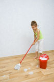 Little girl cleaning the floor Royalty Free Stock Images