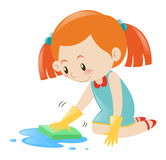 Little girl cleaning floor with sponge Royalty Free Stock Photography