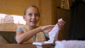 Little girl cleaning her hands with wet towel. stock video