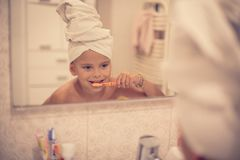 Taking care of her teeth from a young age. stock photography