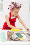 Little girl cleaning the kitchen Royalty Free Stock Photos