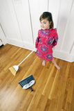 Little Girl Cleaning / Sweeping House Stock Photos