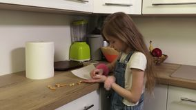 Little girl cleaning table in kitchen stock video