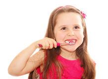 Little girl cleaning teeth Stock Image