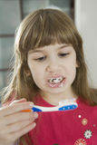 Little girl cleaning teeth Royalty Free Stock Photos