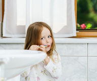 Little girl cleaning the teeth Royalty Free Stock Image