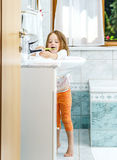 Little girl cleaning the teeth Stock Photo