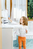 Little girl cleaning the teeth Stock Images