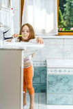 Little girl cleaning the teeth Stock Photography