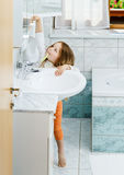 Little girl cleaning the teeth Stock Image