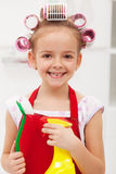 Little girl with cleaning utensils Royalty Free Stock Photography