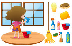 Little girl cleaning window with cloth Stock Photo