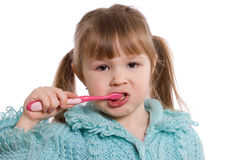 The little girl cleans a teeth Stock Images
