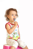 A little girl cleans teeth. A little girl cleans teeth and shows the mood Stock Images