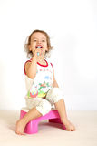 A little girl cleans teeth. Royalty Free Stock Photos
