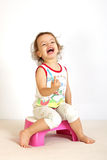 A little girl cleans teeth. A little girl cleans teeth and shows the mood Royalty Free Stock Photo