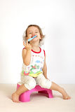 A little girl cleans teeth. A little girl cleans teeth and shows the mood Stock Photography