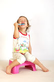 A little girl cleans teeth. Royalty Free Stock Photography