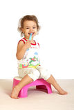 A little girl cleans teeth. Stock Images