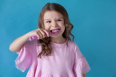Little girl cleans teeth dentistry healthcare nice royalty free stock image