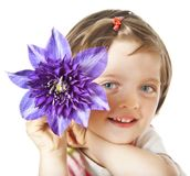 Little girl with clematis flower Royalty Free Stock Images