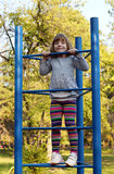 Little girl climb on playground Stock Photos